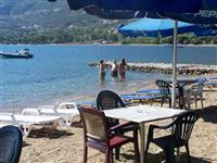 The cafe/taverna just along the beach from your apartments