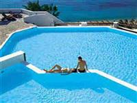 Outdoor communal pool with view of the Aegean sea