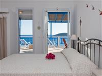 Sunny bedroom with sea view