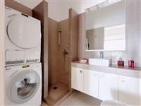 Bathroom which also houses washer and dryer