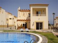 Luxurious three bedroom villa overlooking pool, gym, sauna, jacuzzi and steam room.